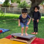 Two boys in an outdoor tumbling class at Little Hoku