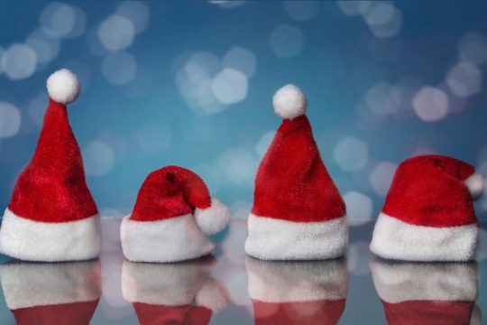 Photo of four santa hats