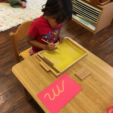 Child working on class activity at a table during the Montessori Connection activities